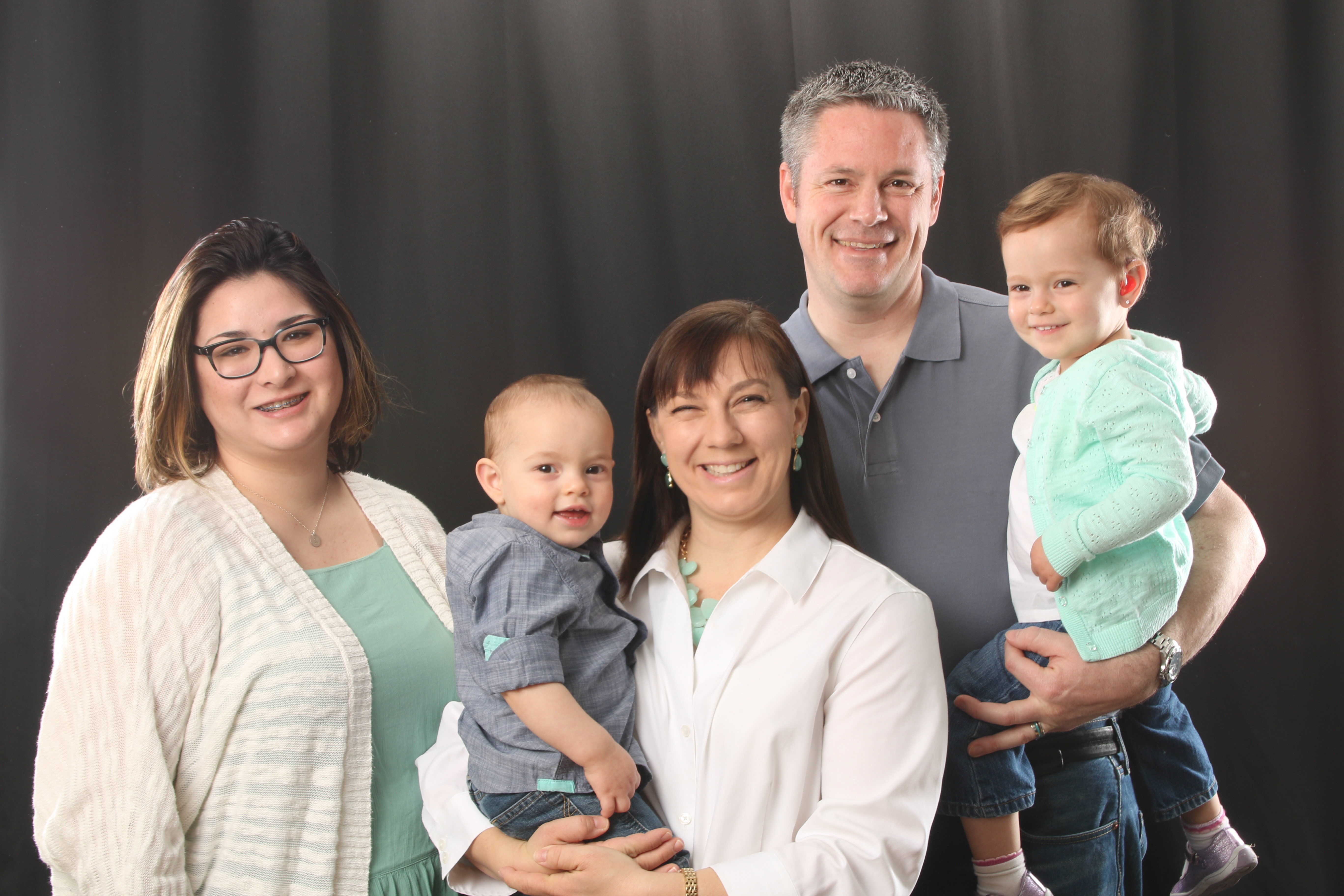 Family supporting newborn hearing loss