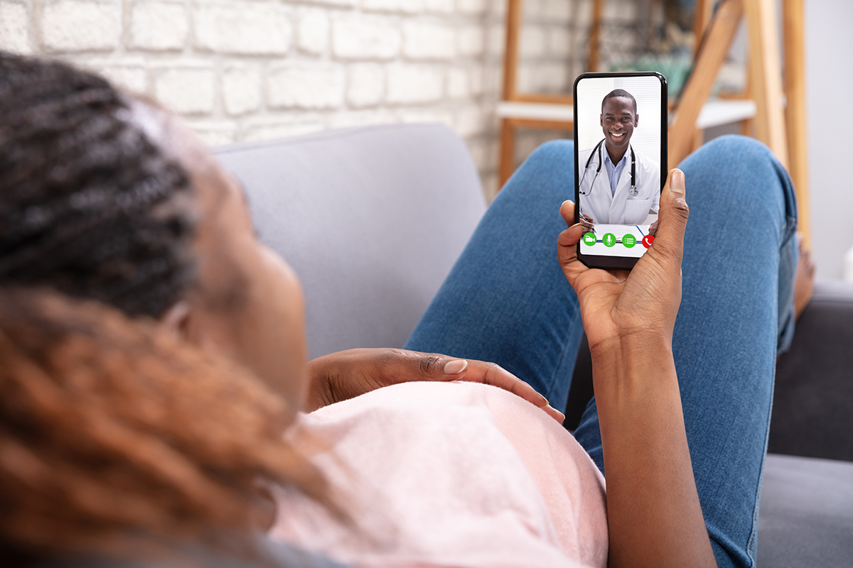 maternal-fetal medicine specialist consulting via telehealth platform